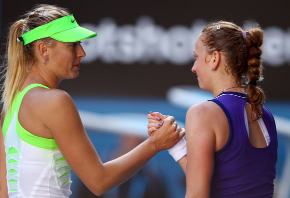 Maria Sharapova of Russia shakes hands with Petra Kvitova of the Czech Republic after winning her semifinal match during day eleven of the 2012 Australian Open