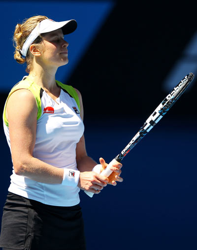 Kim Clijsters of Belgium reacts to a point in her semifinal match against Victoria Azarenka of Belarus during day eleven of the 2012 Australian Open at Melbourne