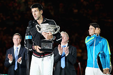 Novak Djokovic speaks after receiving the trophy after winning the men's final