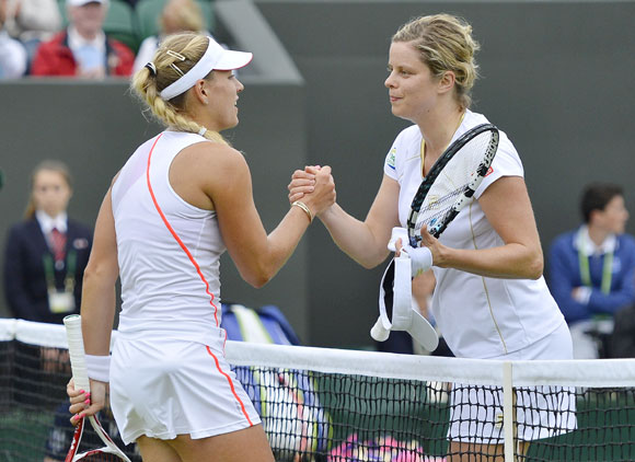 Angelique Kerber of Germany (L) shakes hands with Kim Clijsters of Belgium after defeating her in their women's singles tennis match at the Wimbledon tennis championships in London