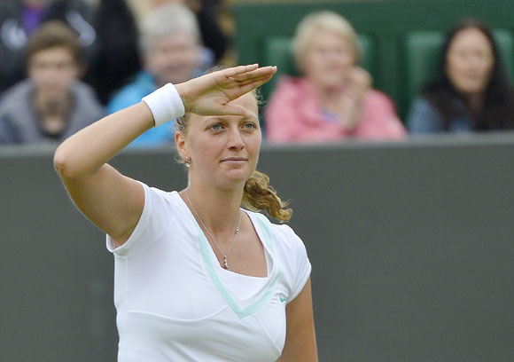 Petra Kvitova of the Czech Republic celebrates after defeating Francesca Schiavone of Italy during their women's singles tennis match at the Wimbledon tennis championships in London