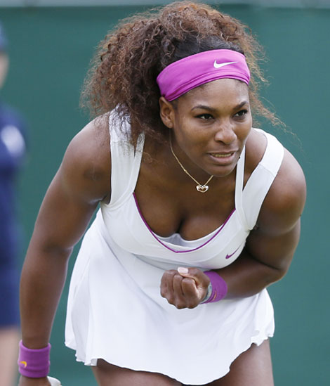 Serena Williams of the U.S. reacts to winning a point during her women's singles tennis match against Yaroslava Shvedova of Kazakhstan at the Wimbledon tennis championships in London