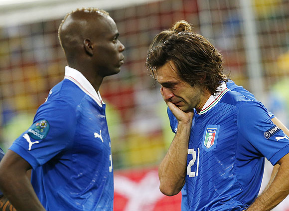 Italy's Andrea Pirlo (right) and Mario Balotelli are crestfallen after losing the Euro final against Spain