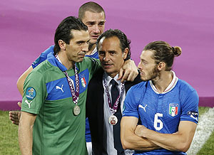 Italy's coach Cesare Prandelli (2nd from right) comforts Gianluigi Buffon, Leonardo Bonucci and Federico Balzaretti after their Euro final loss to Spain