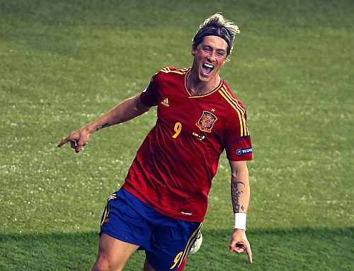 Spain's Fernando Torres celebrates his goal against Italy during their Euro 2012 final match at the Olympic Stadium in Kiev