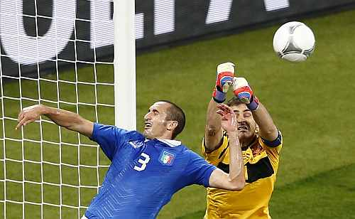 Spain's goalkeeper Iker Casillas (R) makes a save next to Italy's Giorgio Chiellini during their Euro 2012 final match at the Olympic Stadium in Kiev