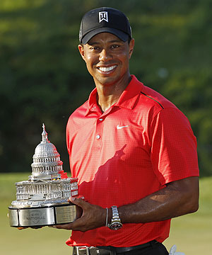 Tiger Woods with the trophy after winning the AT&T National golf tournament in Maryland on Sunday