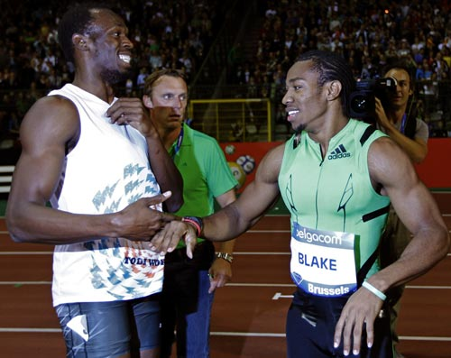 Usain Bolt (left) with Yohan Blake