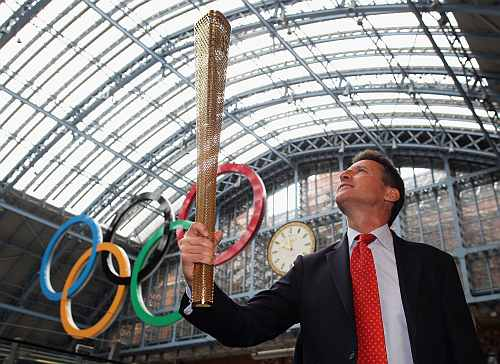 Sebastian Coe with the Olympic torch