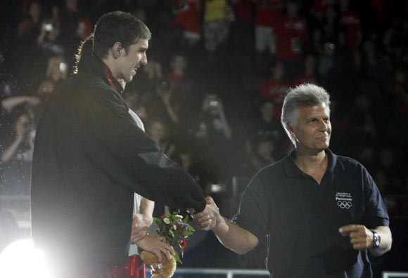 Mark Spitz (right) with Michael Phelps