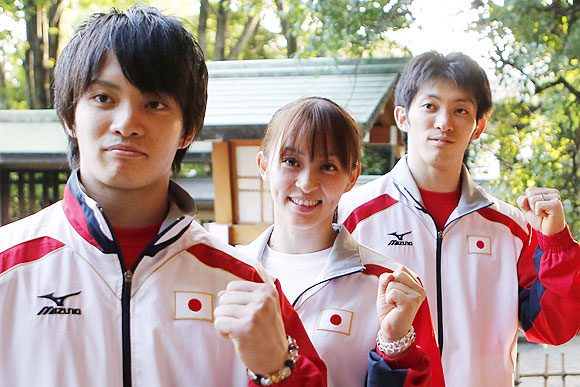 Japanese gymnasts Kazuhito Tanaka, 27, his sister Rie, 25, (centre) and brother Yusuke, 22, (left) pose for photos