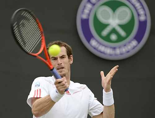 Andy Murray of Britain hits a return to Marin Cilic of Croatia during their men's singles tennis match at the Wimbledon