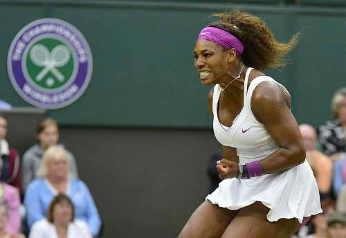 Serena Williams of the U.S. reacts during her women's quarter-final tennis match against Petra Kvitova of the Czech Republic at the Wimbledon