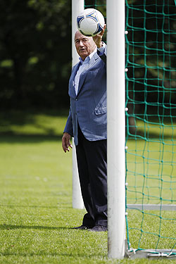 FIFA President Sepp Blatter poses with a ball at the goal line of a goal in Zurich
