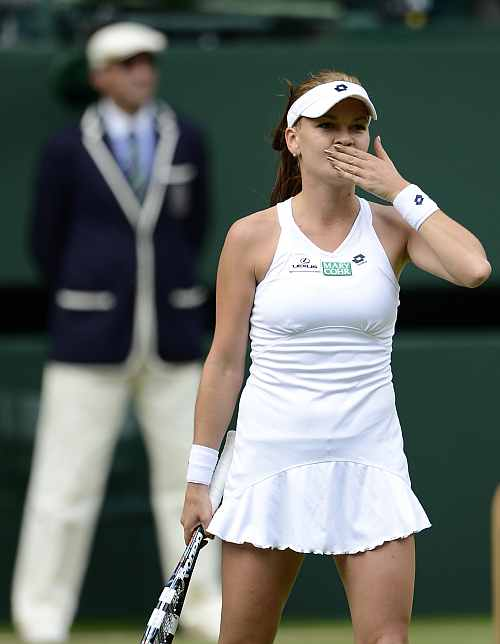Agnieszka Radwanska of Poland celebrates after defeating Angelique Kerber of Germany in their women's semi-final tennis match at the Wimbledon