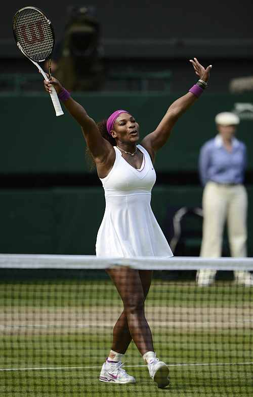 Serena Williams celebrates after defeating Victoria Azarenka in their women's semi-final match at the Wimbledon
