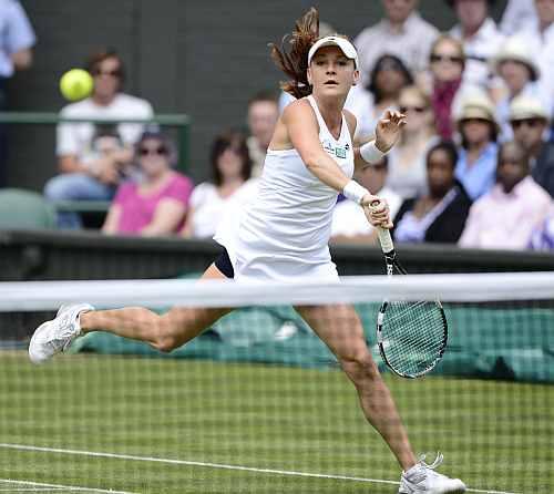 Agnieszka Radwanska hits a return to Angelique Kerber during their women's semi-final match at the Wimbledon