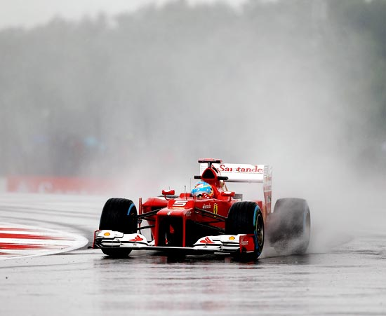 Ferrari's Fernando Alonso drives during practice for the British Grand Prix