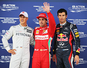 Pole sitter Ferrari's Fernando Alonso (centre) celebrates in with second placed Red Bull's Mark Webber (right) and third placed Mercedes GP's Michael Schumacher following qualifying for the British Grand Prix at Silverstone on Saturday