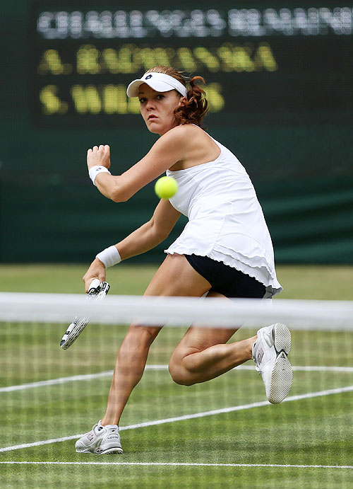 Agnieszka Radwanska hits a forehand return against Serena Williams