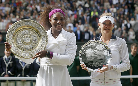 Serena Williams and Agnieszka Radwanska with their trophies at the presentation ceremony