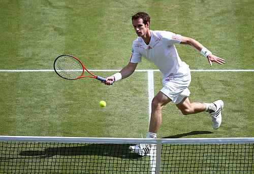 Andy Murray returns a shot during his Men's singles final match against Roger Federer at the Wimbledon