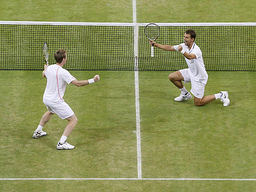 Jonathan Marray of Great Britain (left) and Frederik Nielsen of Denmark celebrate match point