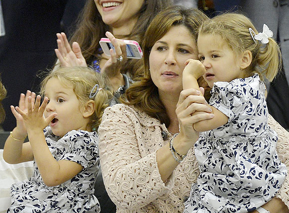 Roger Federer's  wife Mirka Federer with their two-year-old twins Charlene Riva and Myla Rose, after Federer's win on Sunday