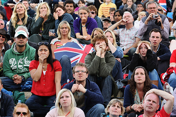 The crowd on Murray Mount react as Andy Murray loses his final against Roger Federer on Sunday