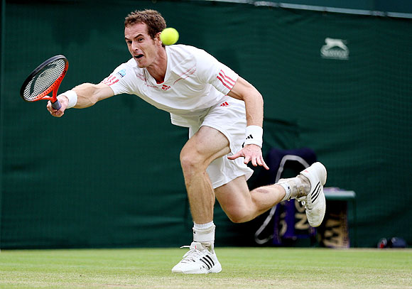 Andy Murray of Great Britain stretches for a forehand during his final against Roger Federer on Sunday