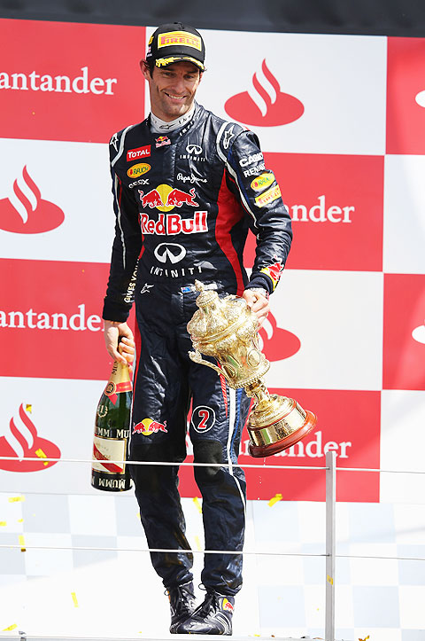 Red Bull Racing's Mark Webber celebrates on the podium after winning the British Grand Prix at Silverstone on Sunday