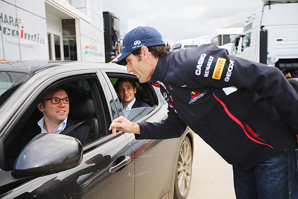 Mark Webber talks with Ferrari Team Principal Stefano Domenicali following the British Grand Prix at Silverstone on Sunday