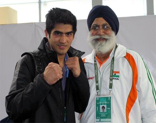 Gurbax Singh Sandhu with Vijender Singh