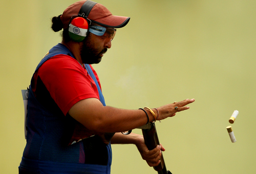 Ronjan Sodhi of India competes in the men's double trap at the Dr Karni Singh Shooting Range during day four of the Delhi 2010 Commonwealth Games