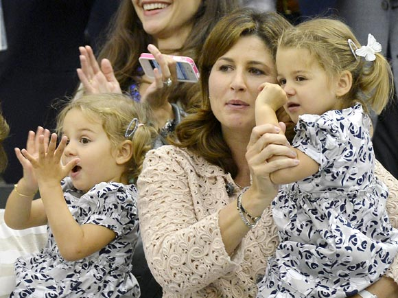 Roger Federer's wife Mirka and their twin daughters Charlene Riva and Myla Rose celebrate his victory in the men's singles final at Wimbledon