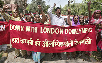 Victims of the 1984 Bhopal gas tragedy shout slogans during a protest against Dow Chemicals' sponsorship deal with the 2012 London Olympics Games, outside the residence of the acting President of the Indian Olympic Association (IOA) Vijay Kumar Malhotra, in New Delhi