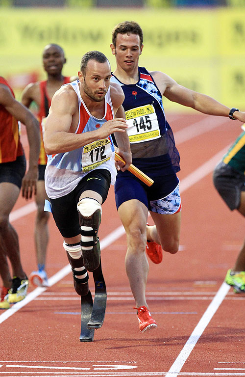Ruan Greyling hands off the relay baton to Oscar Pistorius (left) during the Yellow Pages South African Senior Championship in April
