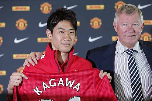 Manchester United's new signing Shinji Kagawa of Japan attends a news conference at Old Trafford stadium in Manchester