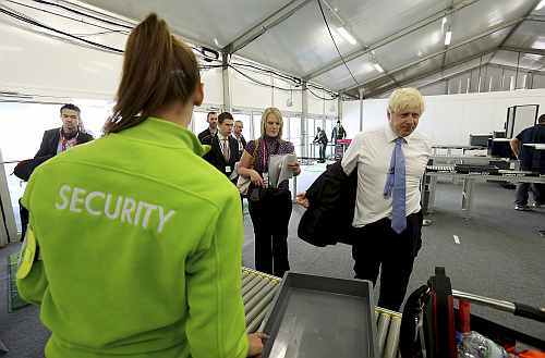 Mayor of London, Boris Johnson, passes through a security check during his visit to the 2012 Olympic Park in London