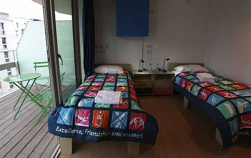 A twin bedroom and balcony in the Olympic Village built for the London 2012 Olympic Games in Stratford