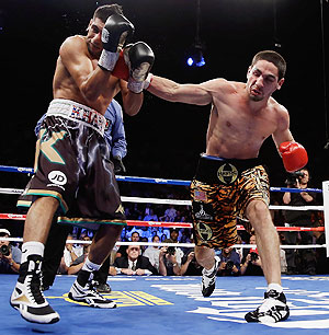 Danny Garcia (right) lands a right hand to the head of Amir Khan