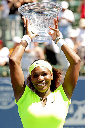 Serena Williams poses for photographers after her win over Coco Vandeweghe in the Stanford Open final on Sunday