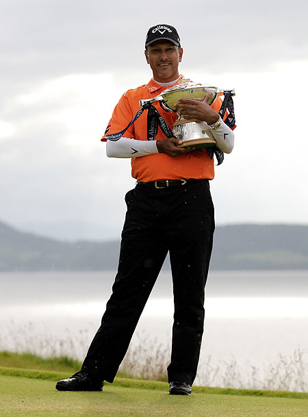 Jeev Milkha Singh of India poses with the trophy after winning the Scottish Open on Sunday