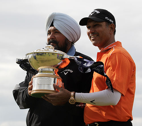 Jeev Milkha Singh and coach Amritinder Singh with the trophy after winning the Scottish Open on Sunday