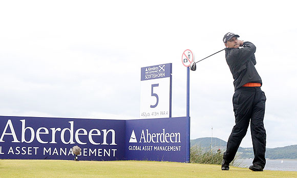 Jeev Milkha Singh of India tees off on the 5th hole during the final round of the Scottish Open on Sunday