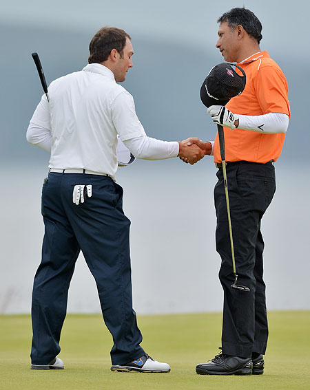 Jeev Milkha Singh (right) greets Francesco Molinari after winning a playoff on the 18th green and with it the Scottish Open on Sunday