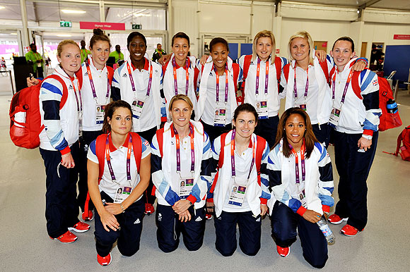 The Great Britain Women's Olympic football team pose in the reception area of the Athletes' Village at the Olympic Park site