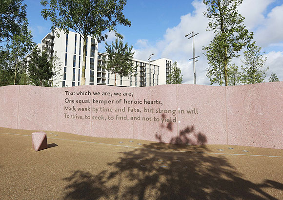 Words from a Ulysses poem by Alfred Tennyson are inscribed in the wall next to the Olympic Village Service Centre