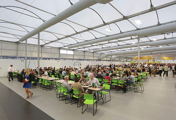 Guests test the 5,000 capacity Olympic Village dining room at the Olympic village