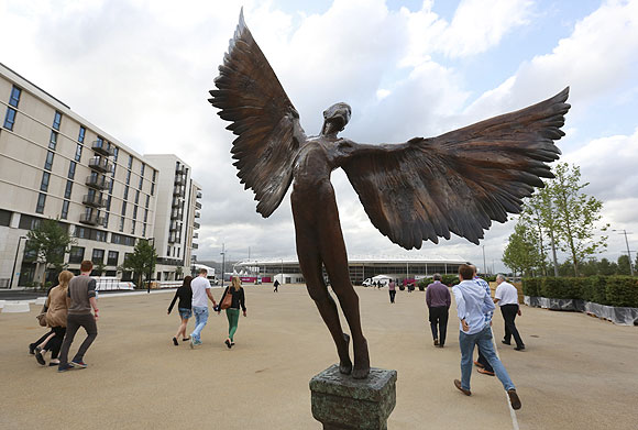 A statue of Icarus marks the way to the 5000 capacity temporary dining hall of the Olympic Village
